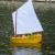 "Not all of our sailboats are competition based.  This sailing Dinghy was scratch built by Admirals member Scott.  Kermit is at the tiller arm and his arm actually looks like it moves the rudder!  Whimsical and fun for all ages.  ""Kermit's Dinghy"" won a 1st Place at the Toledo RC Show!"